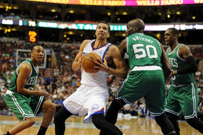 Apr 14, 2014; Philadelphia, PA, USA; Philadelphia 76ers guard Michael Carter-Williams (1) drives to the net as Boston Celtics center Joel Anthony (50) defends in the third quarter of the game at Wells Fargo Center. The Philadelphia 76ers won 113-108. Mandatory Credit: John Geliebter-USA TODAY Sports