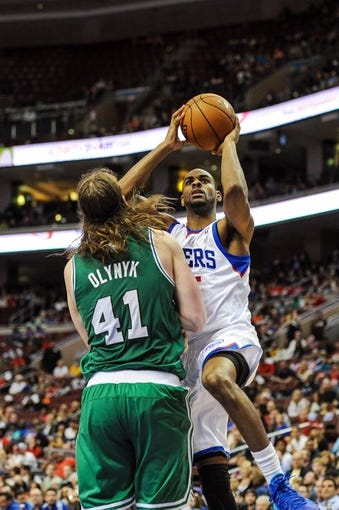 Apr 14, 2014; Philadelphia, PA, USA; Philadelphia 76ers guard Elliot Williams (25) shoots as Boston Celtics center Kelly Olynyk (41) defends in the fourth quarter of the game at Wells Fargo Center. The Philadelphia 76ers won 113-108. Mandatory Credit: John Geliebter-USA TODAY Sports