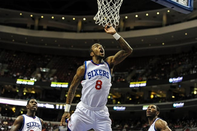 Apr 14, 2014; Philadelphia, PA, USA; Philadelphia 76ers guard Tony Wroten (8) shoots in the fourth quarter of the game against the Boston Celtics at Wells Fargo Center. The Philadelphia 76ers won 113-108. Mandatory Credit: John Geliebter-USA TODAY Sports