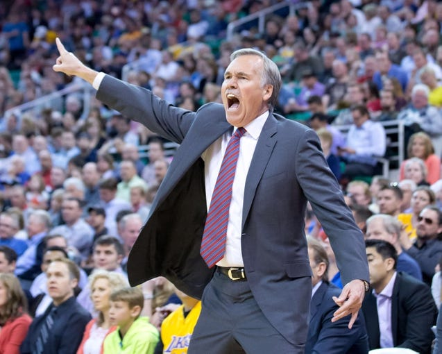 Apr 14, 2014; Salt Lake City, UT, USA; Los Angeles Lakers head coach Mike D'Antoni reacts to a call during the second half against the Utah Jazz at EnergySolutions Arena. The Lakers won 119-104. Mandatory Credit: Russ Isabella-USA TODAY Sports