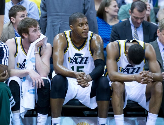 Apr 14, 2014; Salt Lake City, UT, USA; Utah Jazz guard Gordon Hayward (left) and center Derrick Favors (15) and guard Alec Burks (10) react on the bench late during the fourth quarter against the Los Angeles Lakers at EnergySolutions Arena. The Lakers won 119-104. Mandatory Credit: Russ Isabella-USA TODAY Sports
