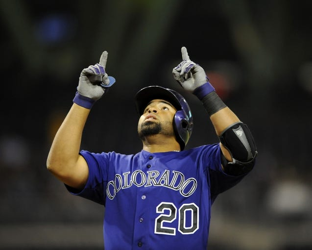 Apr 14, 2014; San Diego, CA, USA; Colorado Rockies catcher Wilin Rosario (20) after a two-run home run during the fifth inning against the San Diego Padres at Petco Park. Mandatory Credit: Christopher Hanewinckel-USA TODAY Sports