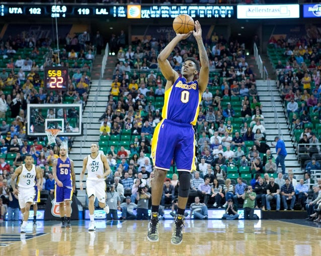 Apr 14, 2014; Salt Lake City, UT, USA; Los Angeles Lakers forward Nick Young (0) shoots during the second half against the Utah Jazz at EnergySolutions Arena. The Lakers won 119-104. Mandatory Credit: Russ Isabella-USA TODAY Sports