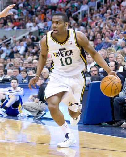 Apr 14, 2014; Salt Lake City, UT, USA; Utah Jazz guard Alec Burks (10) dribbles the ball during the second half against the Los Angeles Lakers at EnergySolutions Arena. The Lakers won 119-104. Mandatory Credit: Russ Isabella-USA TODAY Sports
