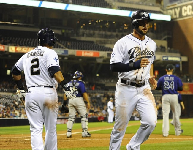 Apr 14, 2014; San Diego, CA, USA; San Diego Padres first baseman Yonder Alonso (right) is congratulated by shortstop Everth Cabrera (2) after scoring during the fifth inning against the Colorado Rockies at Petco Park. Mandatory Credit: Christopher Hanewinckel-USA TODAY Sports