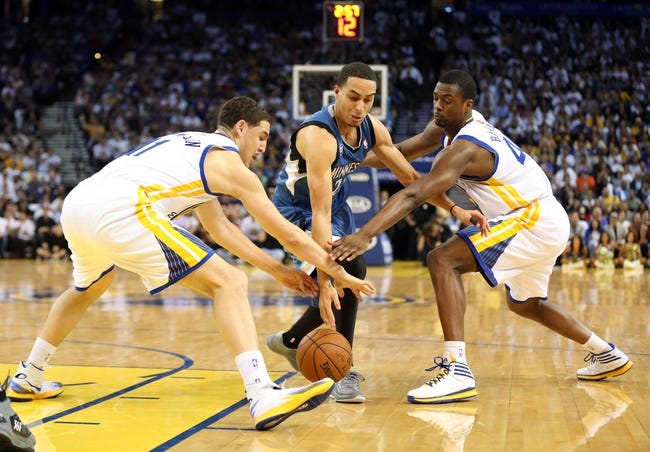 Apr 14, 2014; Oakland, CA, USA; Golden State Warriors guard Klay Thompson (11) and forward Harrison Barnes (40) combine to steal the ball against Minnesota Timberwolves guard Kevin Martin (23) during the second quarter at Oracle Arena. Mandatory Credit: Kelley L Cox-USA TODAY Sports