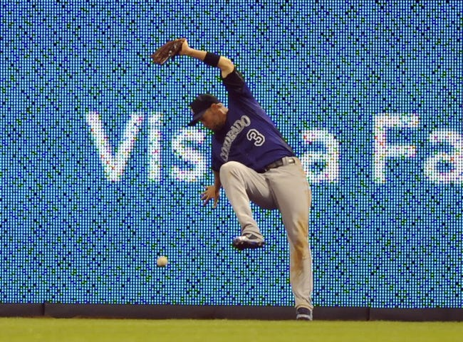 Apr 14, 2014; San Diego, CA, USA; Colorado Rockies right fielder Michael Cuddyer (3) is unable to make a catch on an RBI trople by San Diego Padres center fielder Alexi Amarista (not pictured) during the fifth inning at Petco Park. Mandatory Credit: Christopher Hanewinckel-USA TODAY Sports