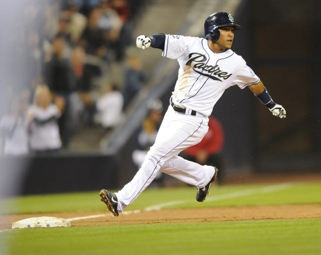 Apr 14, 2014; San Diego, CA, USA; San Diego Padres center fielder Alexi Amarista (5) at third base following a triple during the fifth inning against the Colorado Rockies at Petco Park. Mandatory Credit: Christopher Hanewinckel-USA TODAY Sports