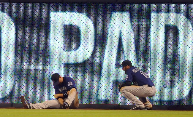 Apr 14, 2014; San Diego, CA, USA; Colorado Rockies right fielder Michael Cuddyer (left) and center fielder Charlie Blackmon (19) after Cuddyer missed a ball during the fifth inning against the San Diego Padres at Petco Park. Cuddyer left the game following the play. Mandatory Credit: Christopher Hanewinckel-USA TODAY Sports