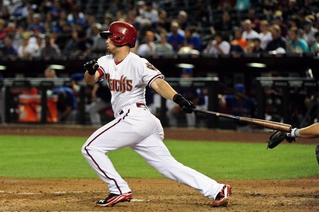 Apr 14, 2014; Phoenix, AZ, USA; Arizona Diamondbacks shortstop Chris Owings (16) hits a single during the third inning against the New York Mets at Chase Field. Mandatory Credit: Matt Kartozian-USA TODAY Sports