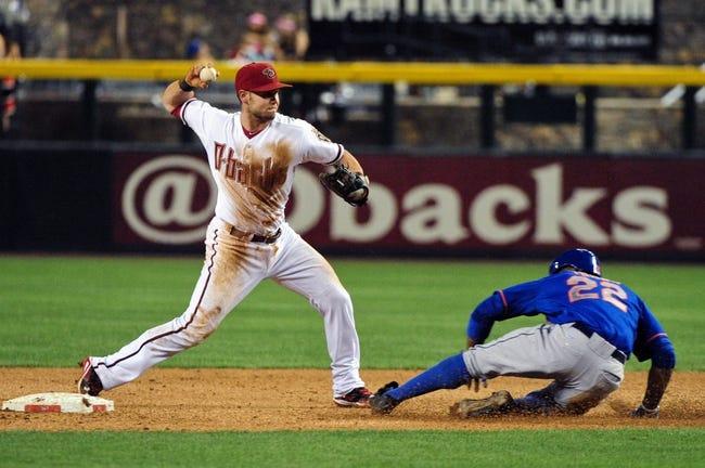 Apr 14, 2014; Phoenix, AZ, USA; Arizona Diamondbacks shortstop Chris Owings (16) throws to first base as New York Mets left fielder Eric Young Jr. (22) slides during the sixth inning at Chase Field. Mandatory Credit: Matt Kartozian-USA TODAY Sports