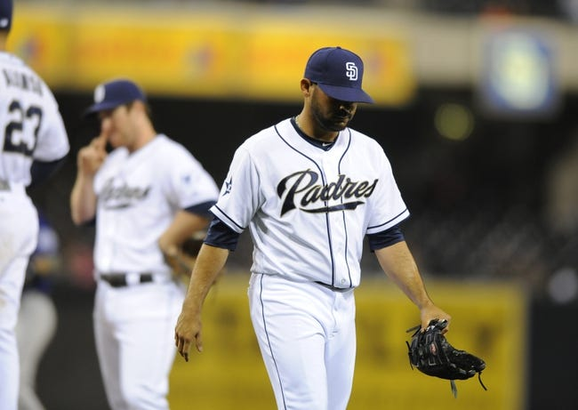 Apr 14, 2014; San Diego, CA, USA; San Diego Padres relief pitcher Alex Torres (54) is taken out of the game after walking the bases loaded during the sixth inning against the Colorado Rockies at Petco Park. Mandatory Credit: Christopher Hanewinckel-USA TODAY Sports