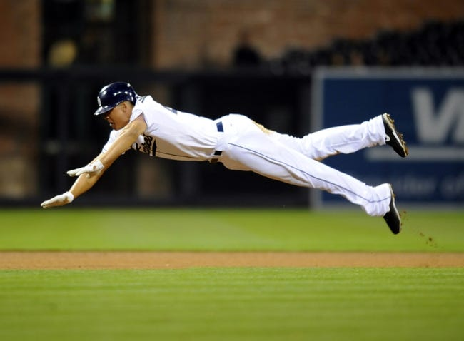 Apr 14, 2014; San Diego, CA, USA; San Diego Padres right fielder Will Venable (25) slides in to third base for a triple during the seventh inning against the Colorado Rockies at Petco Park. Mandatory Credit: Christopher Hanewinckel-USA TODAY Sports