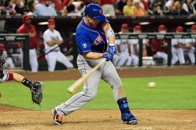 New York Mets third baseman David Wright (5) hits a single during the eighth inning against the Arizona Diamondbacks at Chase Field. Mandatory Credit: Matt Kartozian-USA TODAY Sports