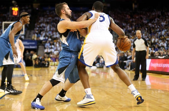 Apr 14, 2014; Oakland, CA, USA; Minnesota Timberwolves guard J.J. Barea (11) fouls Golden State Warriors forward Harrison Barnes (40) during the fourth quarter at Oracle Arena. The Golden State Warriors defeated the Minnesota Timberwolves 130-120. Mandatory Credit: Kelley L Cox-USA TODAY Sports