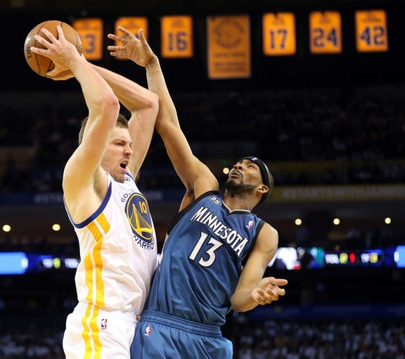Apr 14, 2014; Oakland, CA, USA; Golden State Warriors forward David Lee (10) controls a rebound against Minnesota Timberwolves forward Corey Brewer (13) during the fourth quarter at Oracle Arena. The Golden State Warriors defeated the Minnesota Timberwolves 130-120. Mandatory Credit: Kelley L Cox-USA TODAY Sports