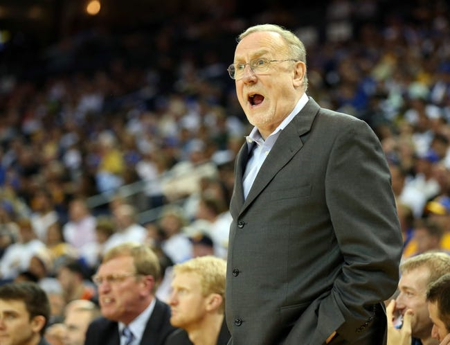 Apr 14, 2014; Oakland, CA, USA; Minnesota Timberwolves head coach Rick Adelman speaks to the referee after a play against the Golden State Warriors during the fourth quarter at Oracle Arena. The Golden State Warriors defeated the Minnesota Timberwolves 130-120. Mandatory Credit: Kelley L Cox-USA TODAY Sports