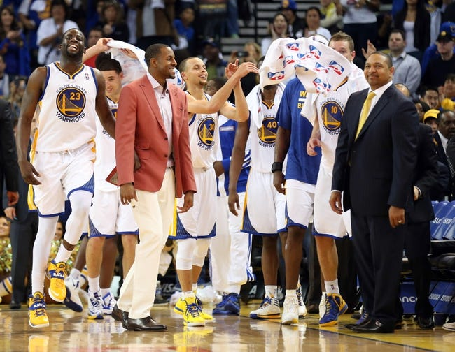 Apr 14, 2014; Oakland, CA, USA; Golden State Warriors players begin to celebrate with head coach Mark Jackson after defeating the Minnesota Timberwolves at Oracle Arena. The Golden State Warriors defeated the Minnesota Timberwolves 130-120. Mandatory Credit: Kelley L Cox-USA TODAY Sports