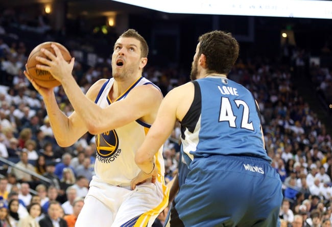 Apr 14, 2014; Oakland, CA, USA; Golden State Warriors forward David Lee (10) looks to shoot the ball against Minnesota Timberwolves forward Kevin Love (42) during the third quarter at Oracle Arena. The Golden State Warriors defeated the Minnesota Timberwolves 130-120. Mandatory Credit: Kelley L Cox-USA TODAY Sports