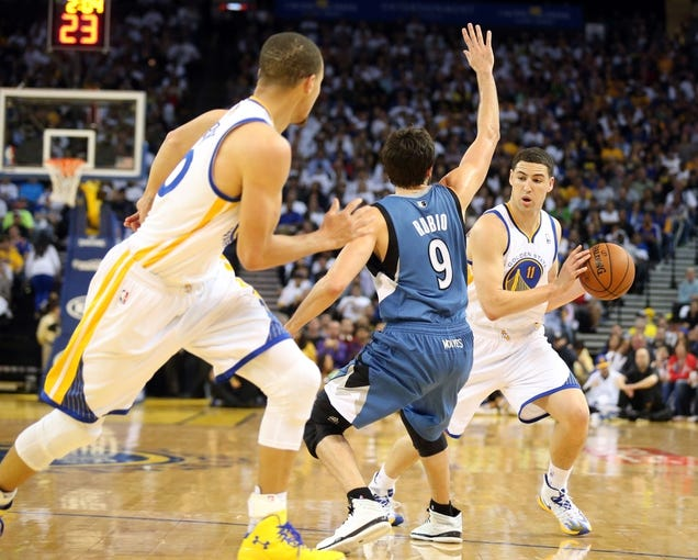 Apr 14, 2014; Oakland, CA, USA; Golden State Warriors guard Klay Thompson (11) looks to pass the ball to guard Stephen Curry (30) against Minnesota Timberwolves guard Ricky Rubio (9) during the third quarter at Oracle Arena. The Golden State Warriors defeated the Minnesota Timberwolves 130-120. Mandatory Credit: Kelley L Cox-USA TODAY Sports