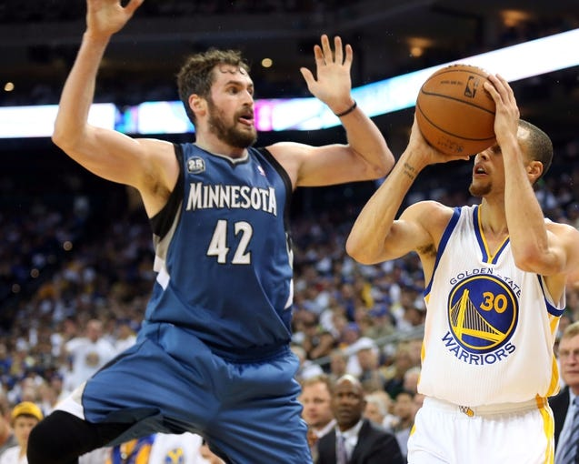 Apr 14, 2014; Oakland, CA, USA; Golden State Warriors guard Stephen Curry (30) shoots the ball against Minnesota Timberwolves forward Kevin Love (42) during the third quarter at Oracle Arena. The Golden State Warriors defeated the Minnesota Timberwolves 130-120. Mandatory Credit: Kelley L Cox-USA TODAY Sports