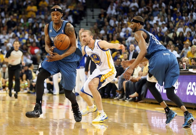 Apr 14, 2014; Oakland, CA, USA; Minnesota Timberwolves forward Dante Cunningham (33) steals the ball against Golden State Warriors guard Steve Blake (25) during the third quarter at Oracle Arena. The Golden State Warriors defeated the Minnesota Timberwolves 130-120. Mandatory Credit: Kelley L Cox-USA TODAY Sports