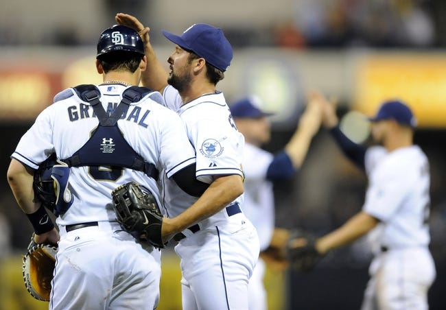 Apr 14, 2014; San Diego, CA, USA; San Diego Padres relief pitcher Huston Street (16) celebrates with catcher Yasmani Grandal (8) after a win against the Colorado Rockies at Petco Park. The Padres won 5-4. Mandatory Credit: Christopher Hanewinckel-USA TODAY Sports