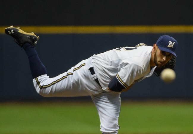 Apr 15, 2014; Milwaukee, WI, USA;  Milwaukee Brewers pitcher Marco Estrada works in the first inning against the St. Louis Cardinals at Miller Park. Mandatory Credit: Benny Sieu-USA TODAY Sports