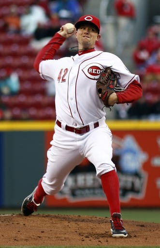 Apr 15, 2014; Cincinnati, OH, USA; Cincinnati Reds starting pitcher Mike Leake throws against the Pittsburgh Pirates during the first inning at Great American Ball Park. Mandatory Credit: David Kohl-USA TODAY Sports