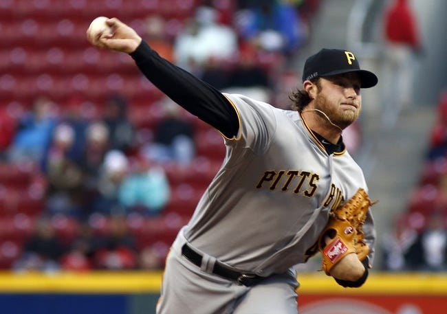 Apr 15, 2014; Cincinnati, OH, USA; Pittsburgh Pirates starting pitcher Gerrit Cole releases a pitch against the Cincinnati Reds during the first inning at Great American Ball Park. Mandatory Credit: David Kohl-USA TODAY Sports