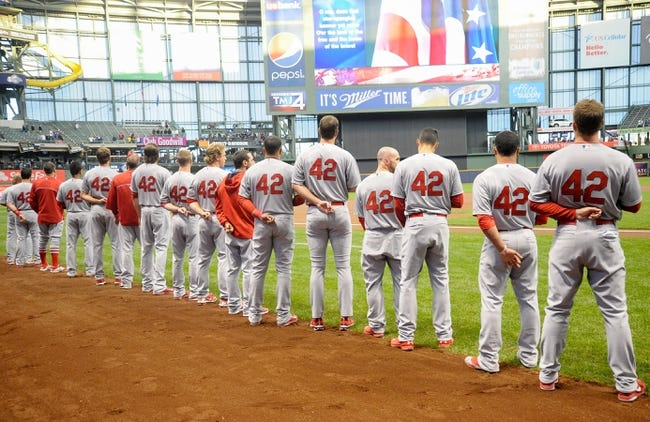 Apr 15, 2014; Milwaukee, WI, USA;  St. Louis Cardinals players wore number 42 on their jersey in honor of Jackie Robinson Day before game against the Milwaukee Brewers at Miller Park. Mandatory Credit: Benny Sieu-USA TODAY Sports