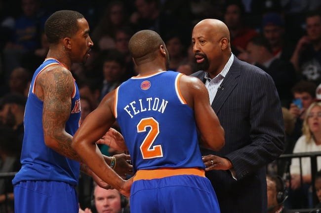 Apr 15, 2014; Brooklyn, NY, USA; New York Knicks head coach Mike Woodson talks with guard Raymond Felton (2)   and guard J.R. Smith (8) during the first quarter against the Brooklyn Nets at Barclays Center. Mandatory Credit: Anthony Gruppuso-USA TODAY Sports