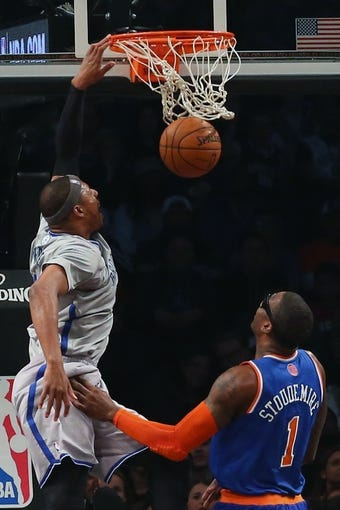 Apr 15, 2014; Brooklyn, NY, USA;  Brooklyn Nets forward Paul Pierce (34) dunks over New York Knicks forward Amar'e Stoudemire (1) during the first quarter at Barclays Center. Mandatory Credit: Anthony Gruppuso-USA TODAY Sports