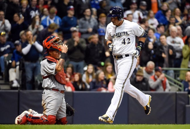 Apr 15, 2014; Milwaukee, WI, USA;  Milwaukee Brewers third baseman Aramis Ramirez (right) scores in front of St. Louis Cardinals catcher Yadier Molina (left) after hitting a solo home run in the fourth inning at Miller Park. Mandatory Credit: Benny Sieu-USA TODAY Sports
