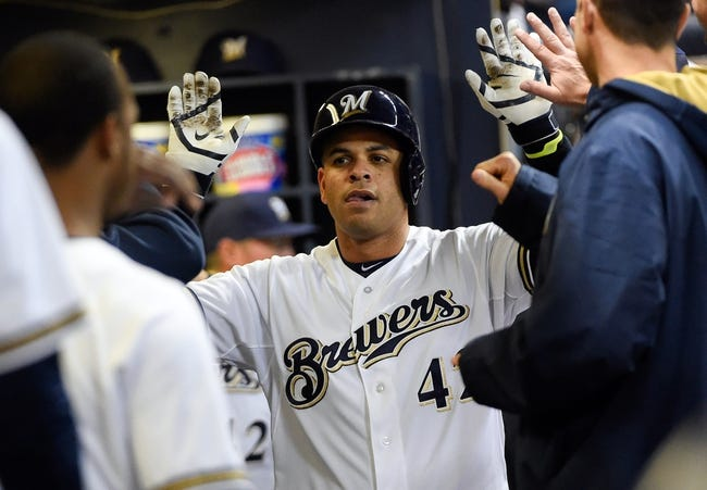 Apr 15, 2014; Milwaukee, WI, USA;  Milwaukee Brewers third baseman Aramis Ramirez is greeted in the dugout after hitting a solo home run in the fourth inning against the St. Louis Cardinals at Miller Park. Mandatory Credit: Benny Sieu-USA TODAY Sports
