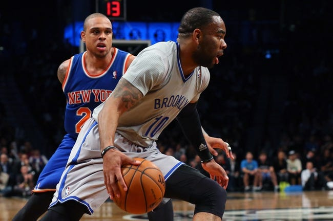 Apr 15, 2014; Brooklyn, NY, USA; Brooklyn Nets guard Marcus Thornton (10) drives past New York Knicks guard Shannon Brown (26) during the third quarter at Barclays Center. New York Knicks won 109-98.  Mandatory Credit: Anthony Gruppuso-USA TODAY Sports