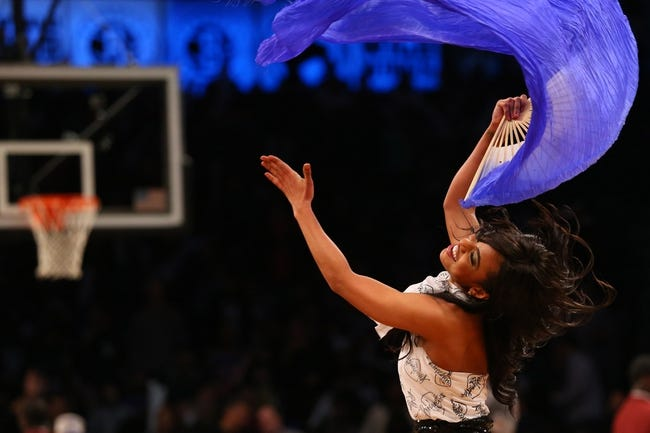 Apr 15, 2014; Brooklyn, NY, USA;  Member of the Brooklynettes performs during the game against the New York Knicks at Barclays Center. New York Knicks won 109-98.  Mandatory Credit: Anthony Gruppuso-USA TODAY Sports