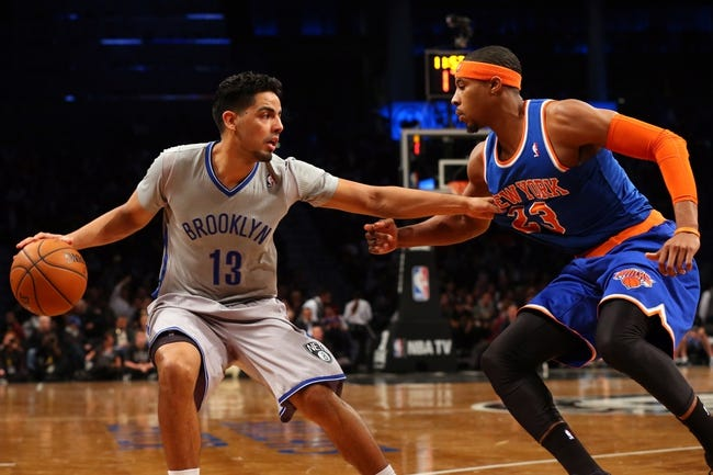 Apr 15, 2014; Brooklyn, NY, USA; Brooklyn Nets guard Jorge Gutierrez (13) holds off New York Knicks guard Toure' Murry (23) during the fourth quarter at Barclays Center. New York Knicks won 109-98.  Mandatory Credit: Anthony Gruppuso-USA TODAY Sports
