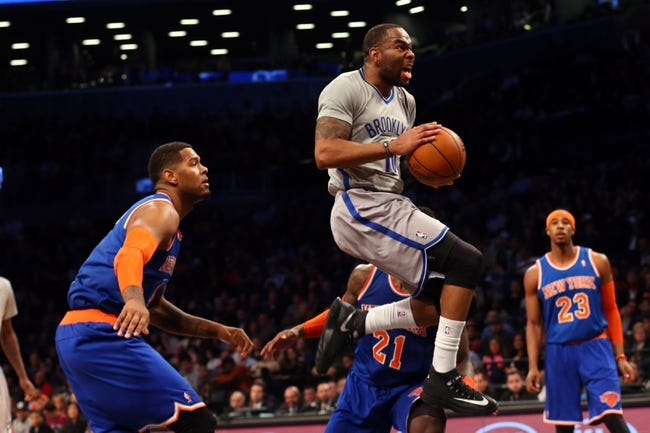 Apr 15, 2014; Brooklyn, NY, USA;  Brooklyn Nets guard Marcus Thornton (10) drives up to the net during the fourth quarter against the New York Knicks at Barclays Center. New York Knicks won 109-98.  Mandatory Credit: Anthony Gruppuso-USA TODAY Sports