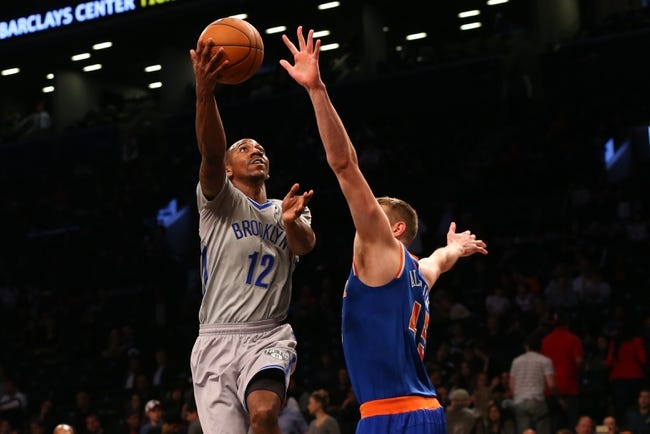 Apr 15, 2014; Brooklyn, NY, USA;  Brooklyn Nets guard Marquis Teague (12) drives up against New York Knicks center Cole Aldrich (45) during the fourth quarter at Barclays Center. New York Knicks won 109-98.  Mandatory Credit: Anthony Gruppuso-USA TODAY Sports