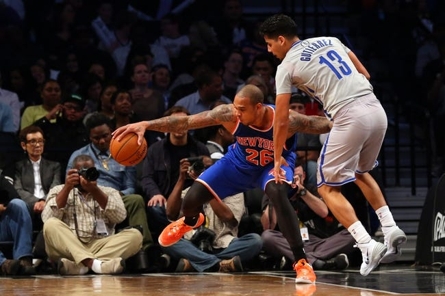 Apr 15, 2014; Brooklyn, NY, USA;  New York Knicks guard Shannon Brown (26) keeps the ball from Brooklyn Nets guard Jorge Gutierrez (13) during the fourth quarter at Barclays Center. New York Knicks won 109-98.  Mandatory Credit: Anthony Gruppuso-USA TODAY Sports