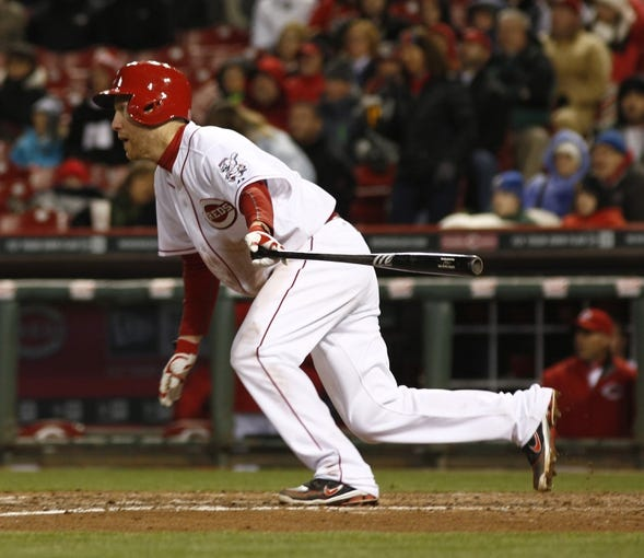 Apr 15, 2014; Cincinnati, OH, USA; Cincinnati Reds third baseman Todd Frazier runs to first after hitting a two-run home run off Pittsburgh Pirates starting pitcher Gerrit Cole during the sixth inning at Great American Ball Park. The Reds won 7-5. Mandatory Credit: David Kohl-USA TODAY Sports