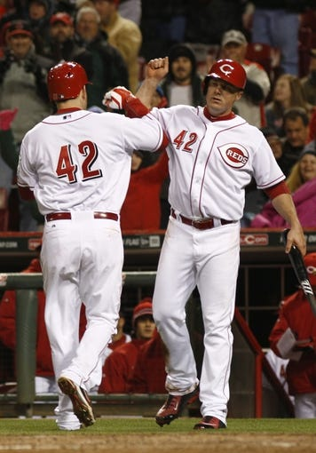 Apr 15, 2014; Cincinnati, OH, USA; Cincinnati Reds third baseman Todd Frazier, left, is congratulated by right fielder Jay Bruce, right, after Frazier hit a two-run home run off Pittsburgh Pirates starting pitcher Gerrit Cole in the sixth inning at Great American Ball Park. The Reds won 7-5. Mandatory Credit: David Kohl-USA TODAY Sports