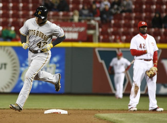 Apr 15, 2014; Cincinnati, OH, USA; Pittsburgh Pirates second baseman Neil Walker, left, rounds the bases past Cincinnati Reds second baseman Brandon Phillips, right, after Walker hit a two-run home run off Cincinnati Reds relief pitcher Manny Parra during the eighth inning at Great American Ball Park. The Reds won 7-5. Mandatory Credit: David Kohl-USA TODAY Sports