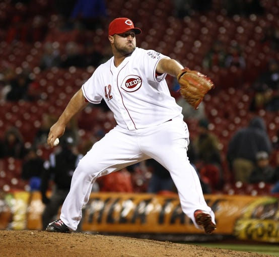 Apr 15, 2014; Cincinnati, OH, USA; Cincinnati Reds relief pitcher Jonathan Broxton throws against the Pittsburgh Pirates during the ninth inning at Great American Ball Park. The Reds won 7-5. Mandatory Credit: David Kohl-USA TODAY Sports