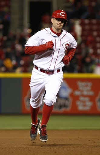Apr 15, 2014; Cincinnati, OH, USA; Cincinnati Reds starting pitcher Mike Leake rounds the bases after hitting a two-run home run off Pittsburgh Pirates starting pitcher Gerrit Cole during the sixth inning at Great American Ball Park. The Reds won 7-5. Mandatory Credit: David Kohl-USA TODAY Sports