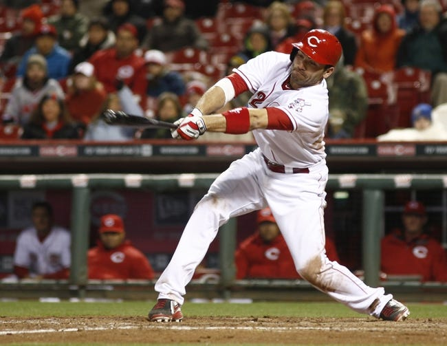 Apr 15, 2014; Cincinnati, OH, USA; Cincinnati Reds first baseman Joey Votto hits a single off Pittsburgh Pirates relief pitcher Jeanmar Gomez during the eighth inning at Great American Ball Park. The Reds won 7-5. Mandatory Credit: David Kohl-USA TODAY Sports