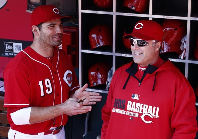 Apr 16, 2014; Cincinnati, OH, USA; Cincinnati Reds first baseman Joey Votto (19) talks with manager Bryan Price, right, prior to a game with the Pittsburgh Pirates at Great American Ball Park. Mandatory Credit: David Kohl-USA TODAY Sports