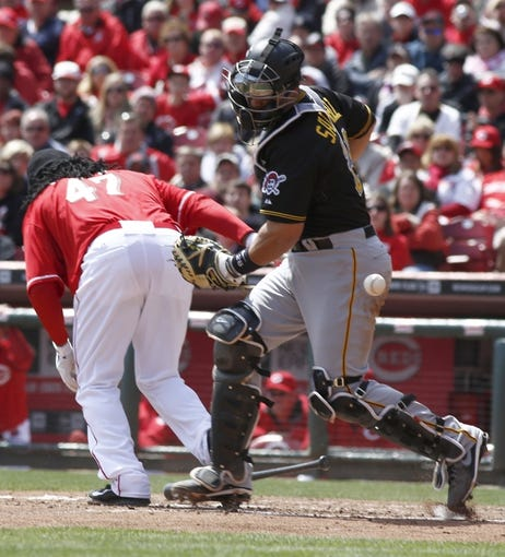 Apr 16, 2014; Cincinnati, OH, USA; Cincinnati Reds starting pitcher Johnny Cueto (47) is called out on batter's interference during the fifth inning at Great American Ball Park. Pittsburgh Pirates catcher Tony Sanchez is at right. The Reds won 4-0. Mandatory Credit: David Kohl-USA TODAY Sports