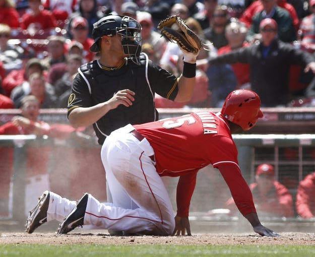 Apr 16, 2014; Cincinnati, OH, USA; Cincinnati Reds left fielder Roger Bernadina (15) is tagged out at home plate by Pittsburgh Pirates catcher Tony Sanchez (26) during the eighth inning at Great American Ball Park. The Reds won 4-0. Mandatory Credit: David Kohl-USA TODAY Sports